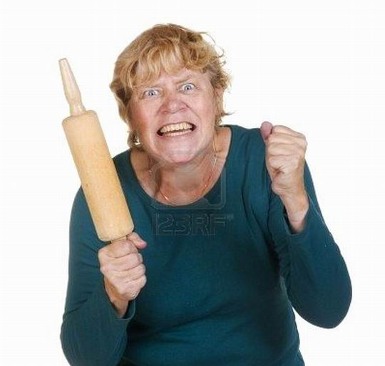 very-furious-woman-with-wooden-roller-pin1