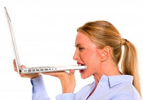 women-biting-laptops-stock-images-01
