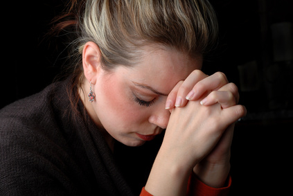a woman is praying to god with hope