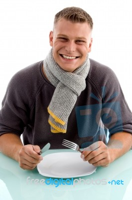 smiling-man-holding-fork-and-knife-100117558