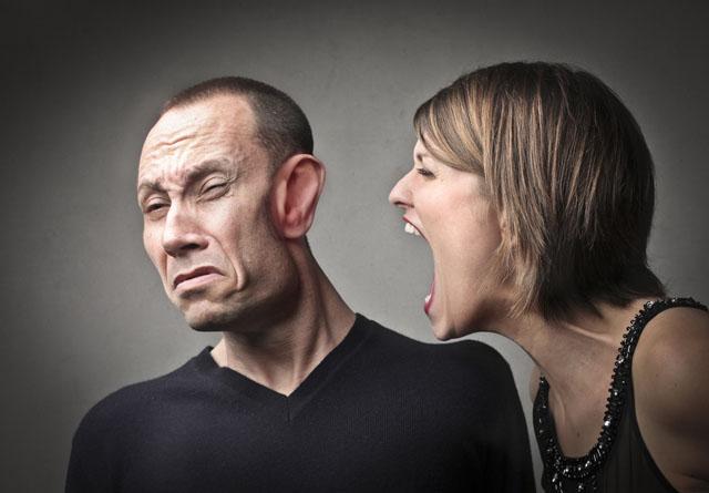 woman-shouting-in-mans-ear
