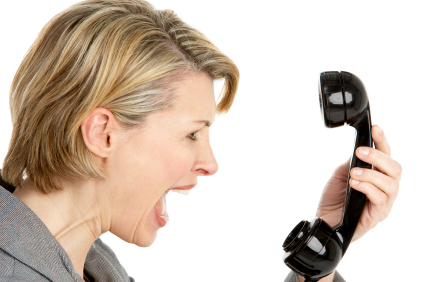 Angry Businesswoman Shouting At Phone