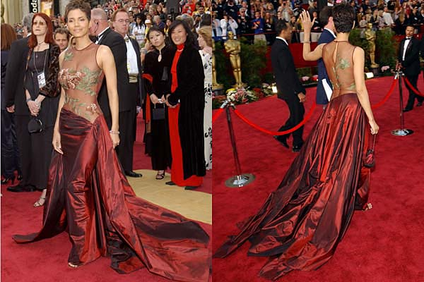 Halle Berry stole the show in 2002 in a sheer, embroidered top and a red ball skirt by designer Elie Saab.