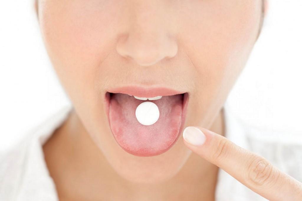 Woman-taking-medication