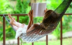young-woman-reading-a-book-lying-in-a-hammock