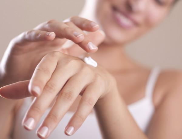 applying hand lotion