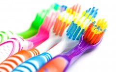 set of multicolored toothbrushes isolated on white