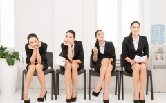 Four different poses of one woman waiting for interview. Sitting in office on chair.