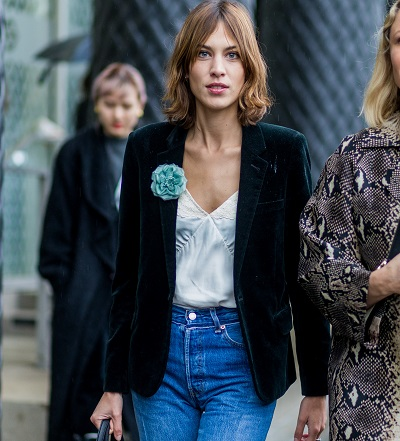 LONDON, ENGLAND, UNITED KINGDOM - FEBRUARY 20: Alexa Chung wearng a dark green velvet blazer a white blouse and a blue denim jeans seen outside Emilia Wickstaed during London Fashion Week Autumn/Winter 2016/17 on February 20, 2016 in London, England. (Photo by Christian Vierig/Getty Images)