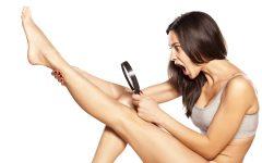shocked girl looking hair on her legs