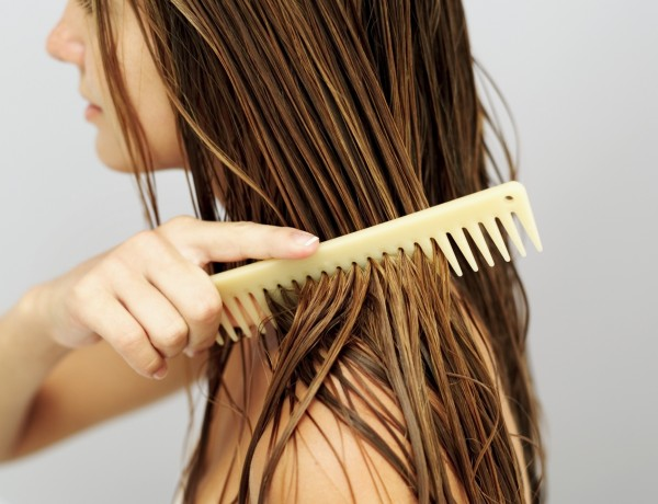 side view of a woman combing her hair