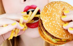 close-up of red lips eating junk food