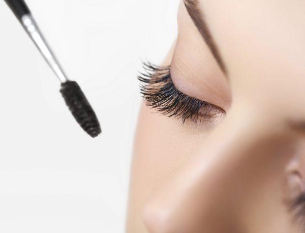 Woman eye with beautiful makeup and long eyelashes. Mascara Brush.